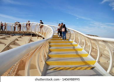 SEVILLE, SPAIN - APRIL 2, 2019: The walkway on the roof of the Metropol Parasol. Completed in 2011, the structure is known as Las Setas de Sevilla (Mushrooms of Seville).