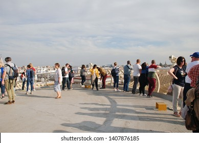 SEVILLE, SPAIN - APRIL 2, 2019: People stand on the rooftop viewing platform of the Metropol Parasol. Completed in 2011, the structure is known as Las Setas de Sevilla (Mushrooms of Seville).