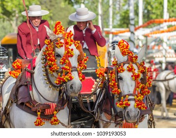 SEVILLE, SPAIN - APRIL, 2014: people in traditional costumes riding horses on fair, April, 2014 in Seville, Spain