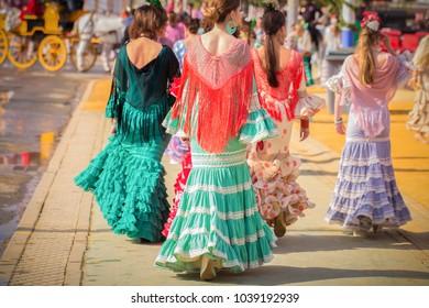 SEVILLE, SPAIN - APRIL 2014: women wearing traditional costumes at Seville April Fair on April,2014 in Seville, Spain