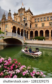 Seville, Spain - April 25, 2015: Tourists in rowboat hamming for a selfie on the canal at Plaza de Espana Seville Spain