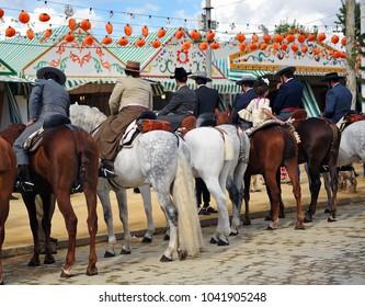 Seville, Spain - April 28, 2012: Group of riders on horseback at the April Fair, Seville Fair (Feria de Sevilla), Andalusia, Spain