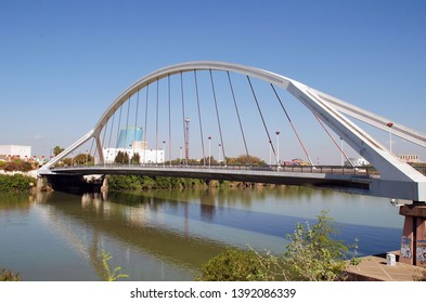 SEVILLE, SPAIN - APRIL 3, 2019: The Puente de la Barqueta ( Bridge of Barges). It was completed in 1992 for access to the Universal Exposition.