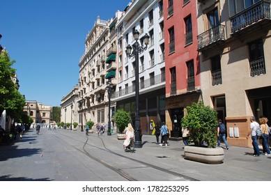 SEVILLE, SPAIN - APRIL 3, 2019: Tram lines run down the Avenida de la Constitucion. The 2km long line was opened in October 2007.