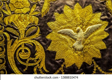 Seville, Spain - April 9,2019: A beautiful detail of an ancient gold embroidery work on 16th century Spanish dalmatic vestment.