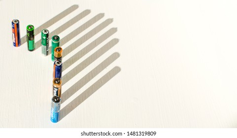 Seville, Spain; August 18, 2019: AAA alkaline batteries and their shadows on a white table. Copy space