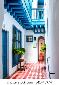 "Seville, Spain, beautiful light and color in a traditional patio of a house in ""barrio de Santa Cruz and Juderia"" in Seville, Andalusia."