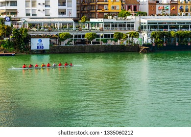 Seville, Spain - Dec 2018: Eight person with a coxswain rowing boat in the Alfonso XII Canal