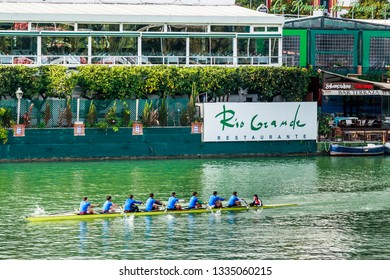 Seville, Spain - Dec 2018: Eight person rowing boat with a coxswain in the Alfonso XII Canal