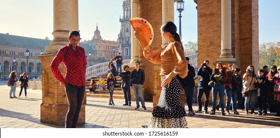 Seville, Spain: Dec 23, 2019: Tourists enjoy street flamenco traditional show, performance for visitors at Plaza de Espana. Travel attraction and fun, Spanish culture art concept panoramic image