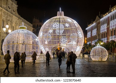 SEVILLE, SPAIN - DECEMBER 15, 2017: Illuminated holiday decorations on San Francisco square near city hall in the center of Seville