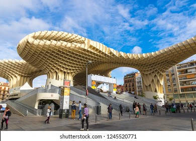 SEVILLE, SPAIN - DECEMBER 15, 2017: The Metropol Parasol (Setas de Sevilla) is a structure in shape of a pergola made of wood and concrete located at La Encarnacion square in Seville old town, Spain
