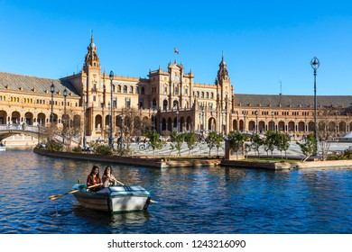 SEVILLE, SPAIN - DECEMBER 16, 2017: South wing of the building and river at the Spain Square (Plaza de Espana) in Seville (Sevilla) city, Andalusia, Spain. Example of Moorish and Renaissance revival