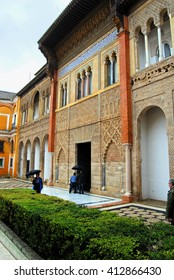 SEVILLE, SPAIN - DECEMBER 29, 2009: One of the courtyards with Moorish architecture inside the Alcazar on a rainy day, Seville, Spain.