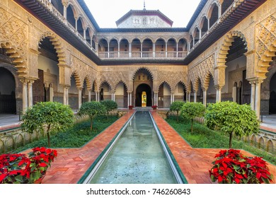 SEVILLE, SPAIN - DECEMBER 29, 2017: Real Alcazar in Seville. Patio de las Doncellas. One of the most beautiful landmarks in Real Alcazar Palace.