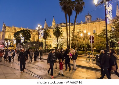 Seville, Spain - December 6, 2016: People activity around Seville Cathedral of Saint Mary of the See (Seville Cathedral) at Christmas time