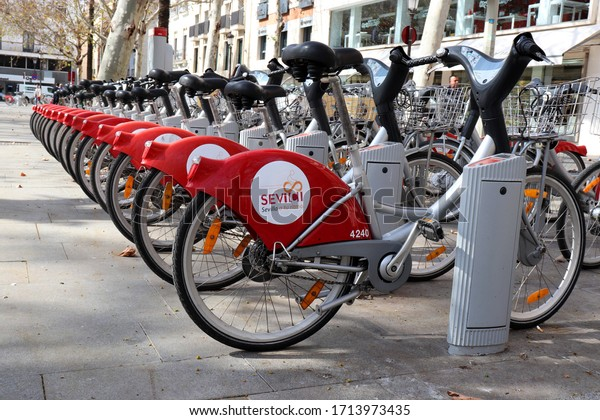 SEVILLE, SPAIN - FEBRUARY 20: Some bicycles of the Sevici rental service in Sevilla, Spain on February 20, 2020. With the bike sharing service people can rent bicycles for short trips.