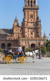 Seville Spain and horse carriage plaza de espana in summer