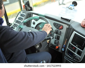 Seville, spain - Jan 1, 2013: driver of a passenger bus sitting in his seat driving the steering wheel and dashboard.