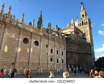 Seville, Spain - January 2018: View of the Cathedral of Santa Maria de la Sede from the Avenida de la Constitución. Street frequented by the public, horse carriages and tram