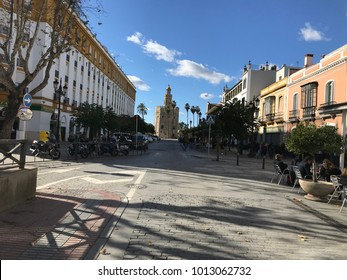 Seville, Spain - January 2018: View between the streets of the famous Torre del Oro next to the Guadalquivir river, Declared a historic and artistic monument