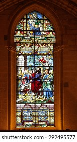 SEVILLE, SPAIN - JANUARY 3, 2013: One of stained glass windows of the Seville cathedral. Built in 1528, the cathedral is listed as UNESCO World Heritage site since 1987