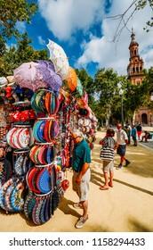 Seville, Spain - July 15, 2018: Sale of souvenirs in Seville near Plaza de Espana
