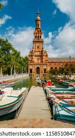 Seville Spain - July 15, 2018: Boats and tourists on the canal in Spain Square or Plaza de Espana, Seville, Andalusia