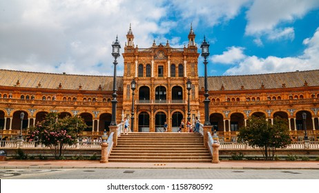Seville, Spain - July 15, 2018: Spain Square, Plaza de Espana, is in the Public Maria Luisa Park, in Seville. It is a landmark example of the Renaissance Revival style in Spanish architecture