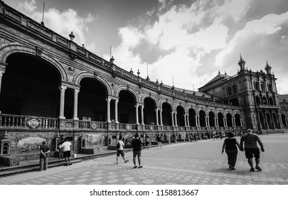 Seville, Spain - July 15, 2018: Monochrome Spain Square, Plaza de Espana, is in the Public Maria Luisa Park, in Seville, a landmark example of the Renaissance Revival style in Spanish architecture