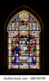 SEVILLE, SPAIN - JULY 29, 2012: Stained-glass window in Seville cathedral