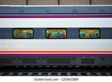 Seville, Spain - Jun 4, 2015: Stopped train inside the modern train station of Seville Santa Justa opened in 1991 with connections to Madrid, Valencia and Barcelone.