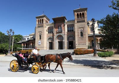 SEVILLE, SPAIN - JUNE 10: Horse drawn carriage in front of the Museum of Arts and Traditions in Seville. June 10th 2012 in Seville, Andalusia, Spain