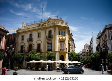 Seville, Spain- June 18, 2017 : A car passes by on the empty streets in Seville, Spain June 2017, Europe