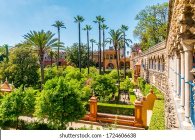 Seville, Spain - June 19, 2019: Moorish architecture of beautiful castle called Real Alcazar in Seville, Andalusia, Spain