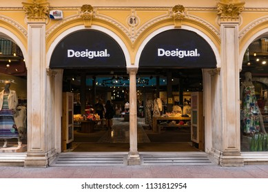 SEVILLE, SPAIN - JUNE 2018: Desigual shop window. Desigual is a manufacturer of clothing and footwear based in Barcelona.