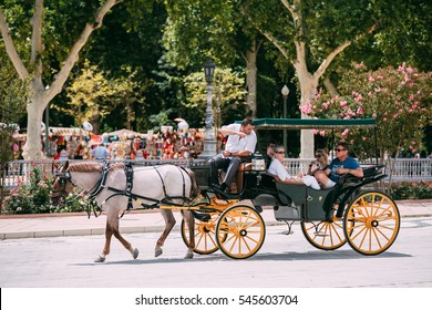 Seville, Spain - June 24, 2015: Horse drawn carriage in Plaza de Espana in Seville, Andalusia, Spain. Spain Square.