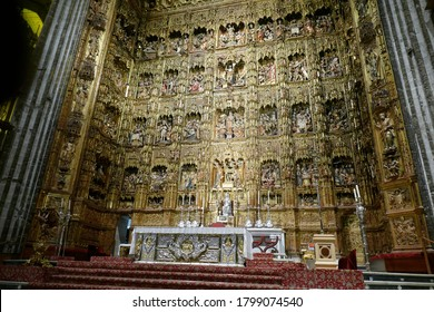 SEVILLE, SPAIN - MAR 6, 2020 - Life and Passion of Jesus Christ and Mary in golden niches behind the altar of the Cathedral of Sevilla, Andalucia, Spain