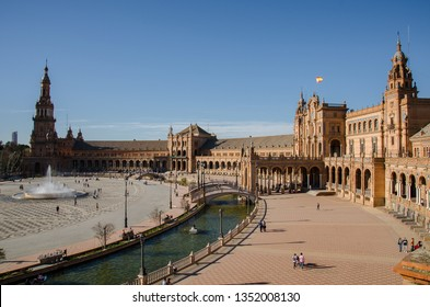 Seville, Spain - March 12 2017: View over Spain Square (Plaza de España), in Seville, a landmark example of the Regionalism Architecture, mixing elements of the Renaissance Revival and Moorish Revival