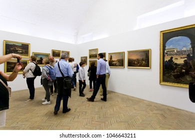 SEVILLE, SPAIN, March 18, 2017: Turists visiting the famous museum of Plaza de toros, bullfight arena, in Seville, Andalusia, Spain