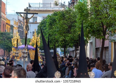 SEVILLE, SPAIN - MARCH 27: Crowd watches a Holy Week procession featuring Jesus in Seville, Spain on March 27, 2018