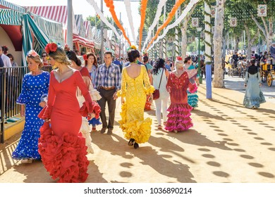 Seville, Spain - May 03, 2017:  People taking a walk and dressed in traditional costumes at the Seville's April Fair.