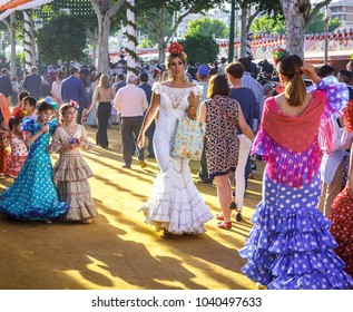 Seville, Spain - May 03, 2017:  Attractive Women taking a walk and dressed in traditional costumes at the Seville's April Fair.