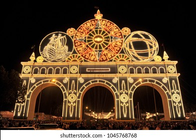 Seville, Spain - May 04, 2011: Entrance arch (Portada) to the April Fair illuminated by thousands of light bulbs at night, Seville Fair (Feria de Sevilla), Andalusia, Spain