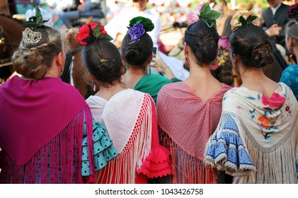 Seville, Spain - May 08, 2014: Beautiful spanish girls at the April Fair, Seville Fair (Feria de Sevilla), Andalusia, Spain
