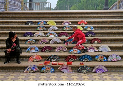 Seville, Spain - May 10, 2018: woman is selling fans at Plaza de Espana in Seville, Spain