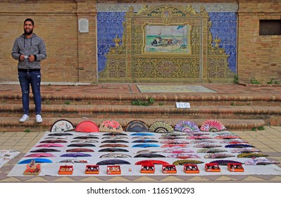 Seville, Spain - May 10, 2018: man is selling fans at Plaza de Espana in Seville, Spain