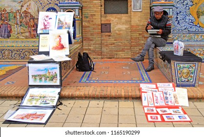 Seville, Spain - May 10, 2018: man is selling pictures at Plaza de Espana in Seville, Spain