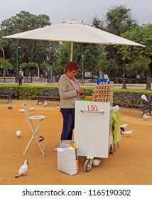 Seville, Spain - May 10, 2018: woman sells birdseed for pigeons at Plaza de Espana in Seville, Spain