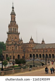 Seville, Spain - May 10, 2018: people are walking by Spain Square or Plaza de Espana in Seville, Spain